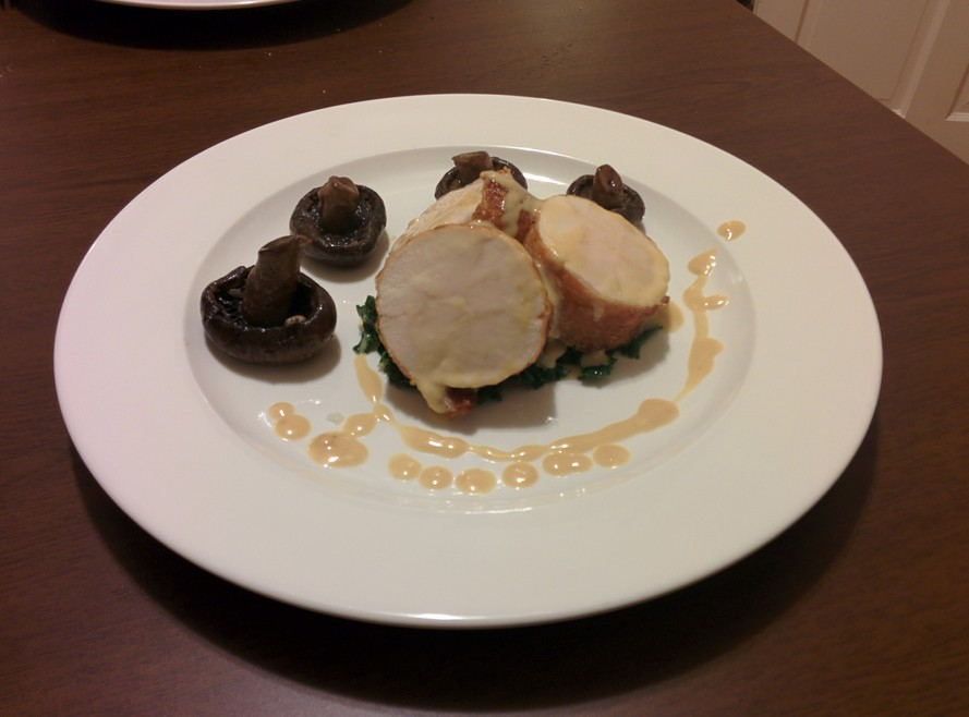 chicken roulade with a creamy chicken jus sous vide kale and pan